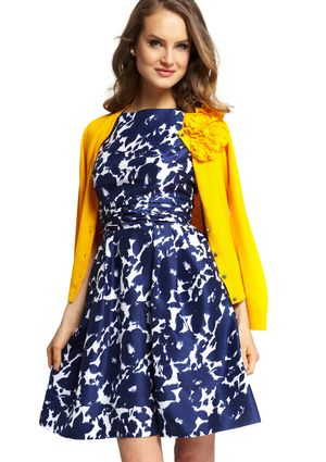 This reminds me of Emma Pillsbury :)  (Christina H.) Garden Party Flower Dress  (Love the yellow cardigan!)