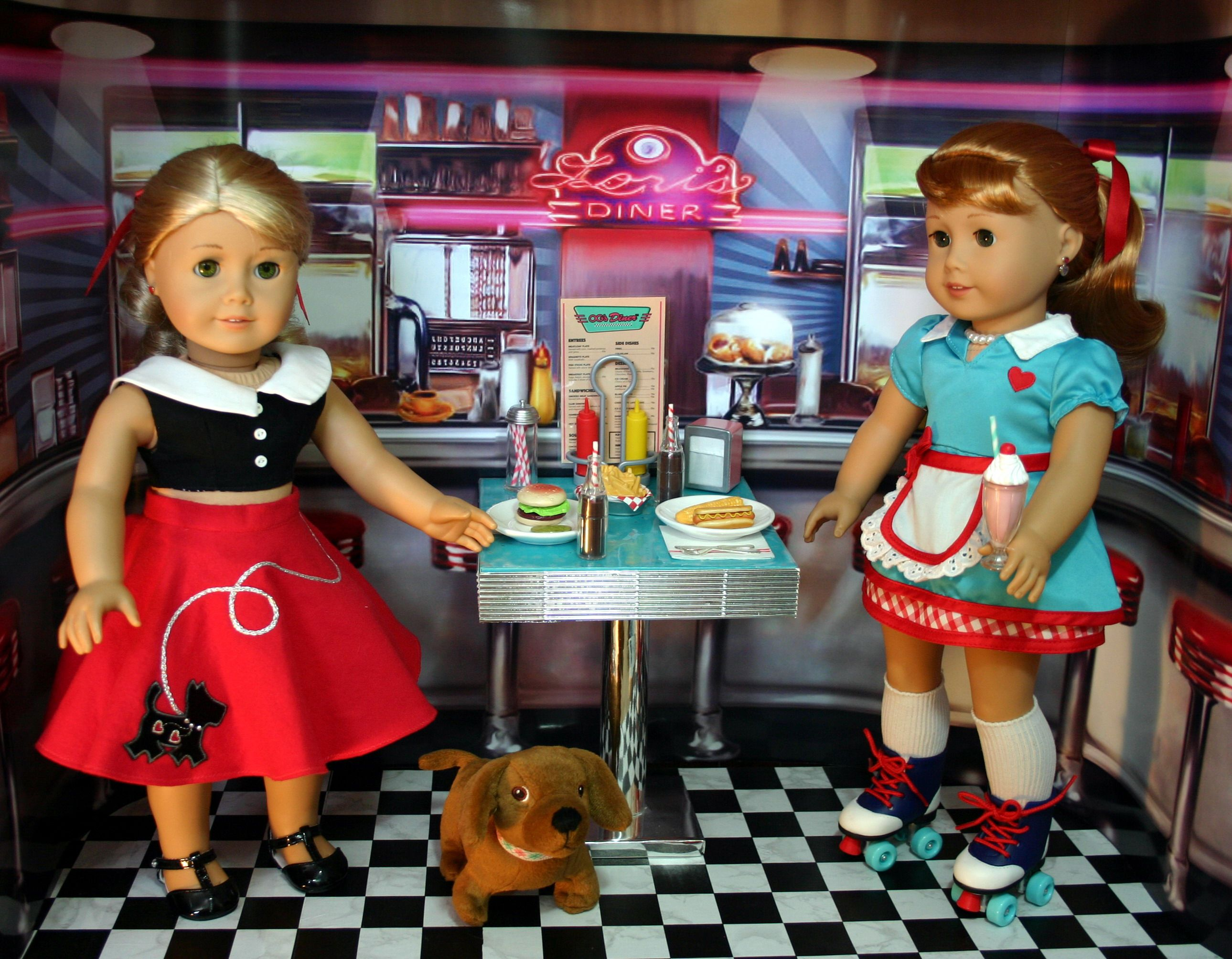 American Girl Dolls Lanie, Maryellen, and her dog scooter
