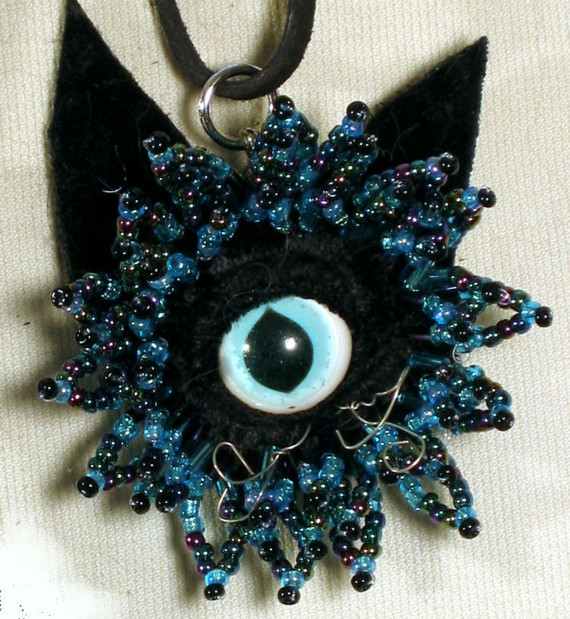 Hypnotic turquoise Hexcat pendant.... Can you stare down a cat?