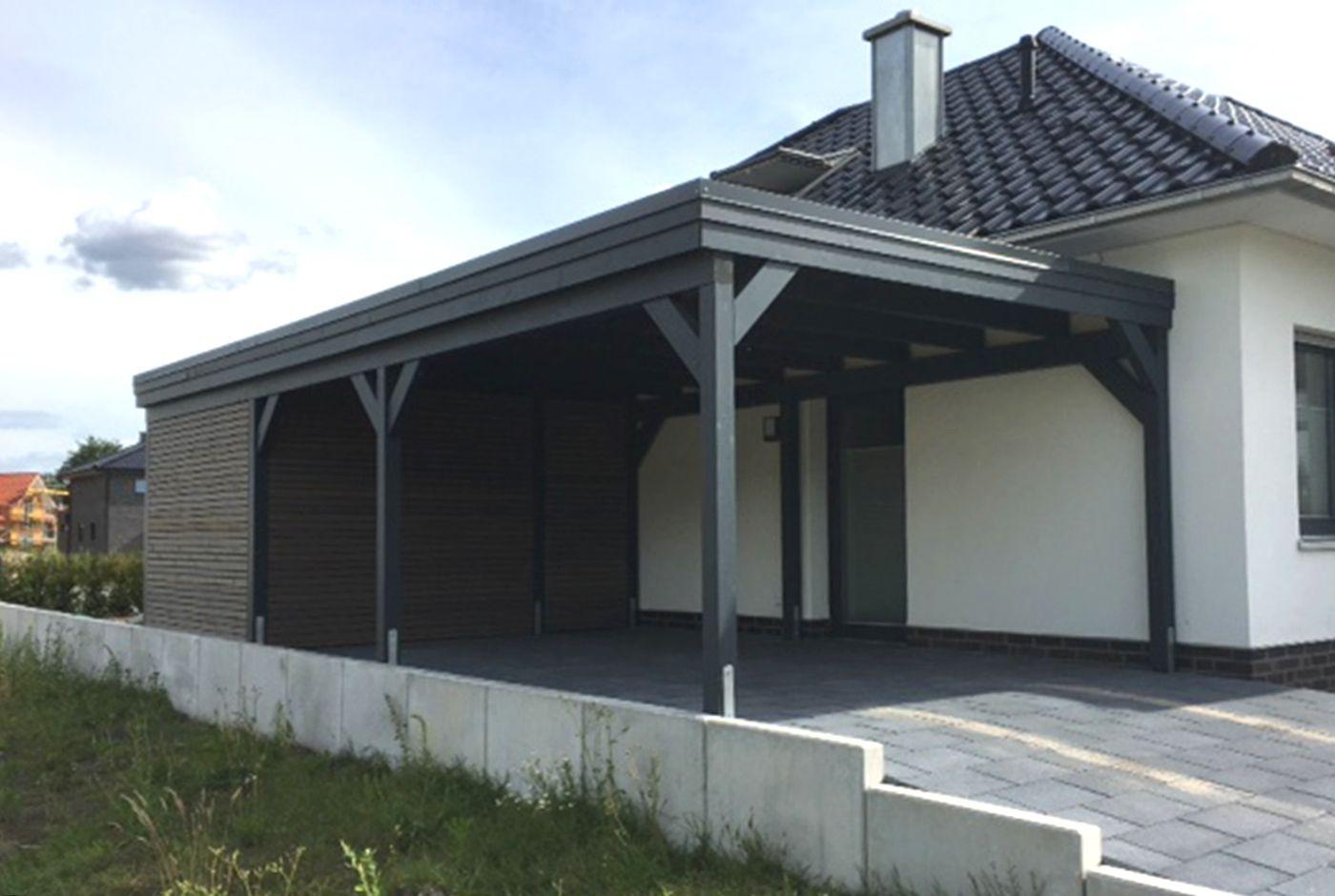 ein carport aus leimholz in anthrazit mit einem ger teraum aus rhombusleisten mit holzt r so. Black Bedroom Furniture Sets. Home Design Ideas