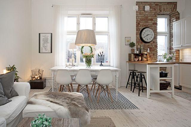 Zachwycająca aranżacja mieszkania w stylu skandynawskim z wykorzystaniem ściany z czerwonej cegły - chcę tu mieszkać!