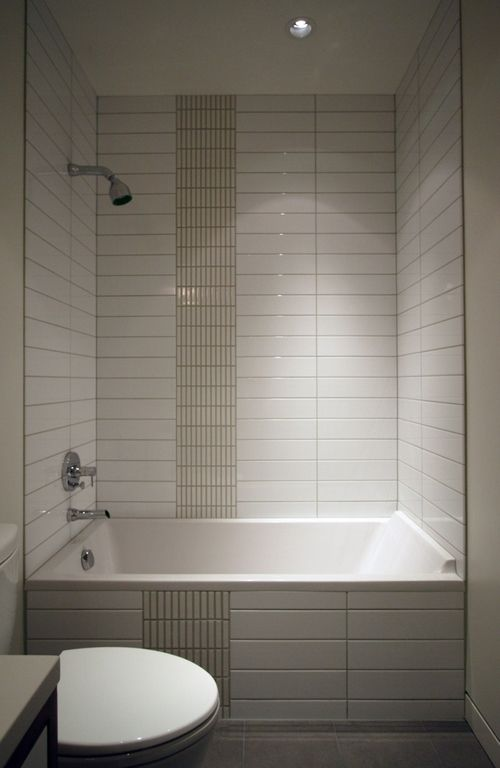 Dramatically Stacked White Tile Tub And Shower By Bright