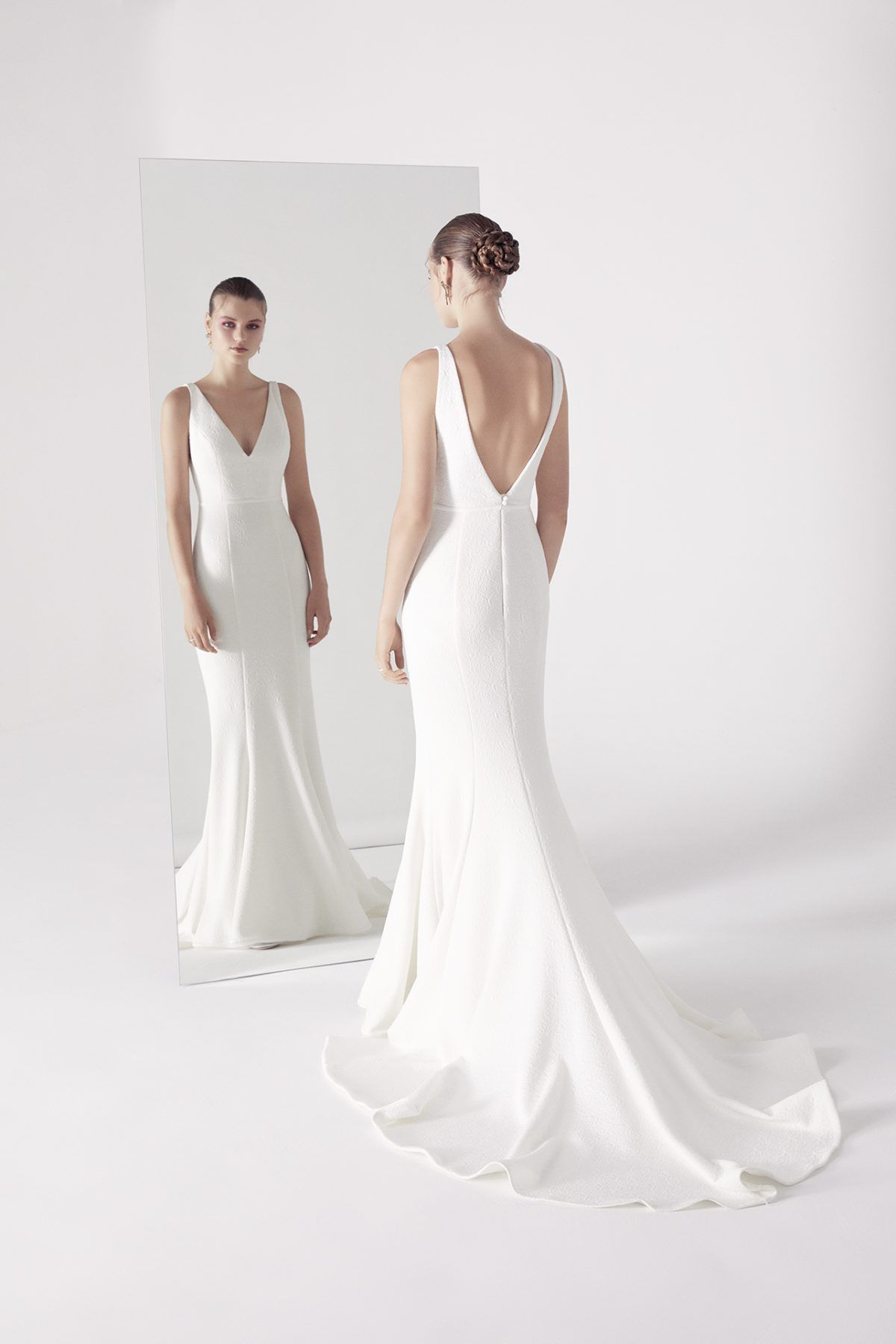 eacf27bc8a Simple fit and flare v-neck wedding dress.