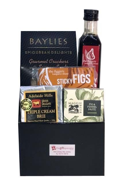 K.I.+Fig+Hamper+-+This+gorgeous+Kangaroo+Island+&+SA+Gourmet+gift+contains:+KI+Sticky+Fig+Syrup+250ml+(perfect+on+Ice+cream+or+pancakes)++1+x++packet+of+Sticky+Figs+150+g,+Baylies+Sesame+Crackers,+Maggie+Beer+Paste+100g+and+Udderly+Delights+Triple+Cream+Cheese..+These+unique+SA+&+Kangaroo+Island+products+are+a+must+to+have...+Gift+Hamper+comes+in+a+gloss+box+&+ribbon.