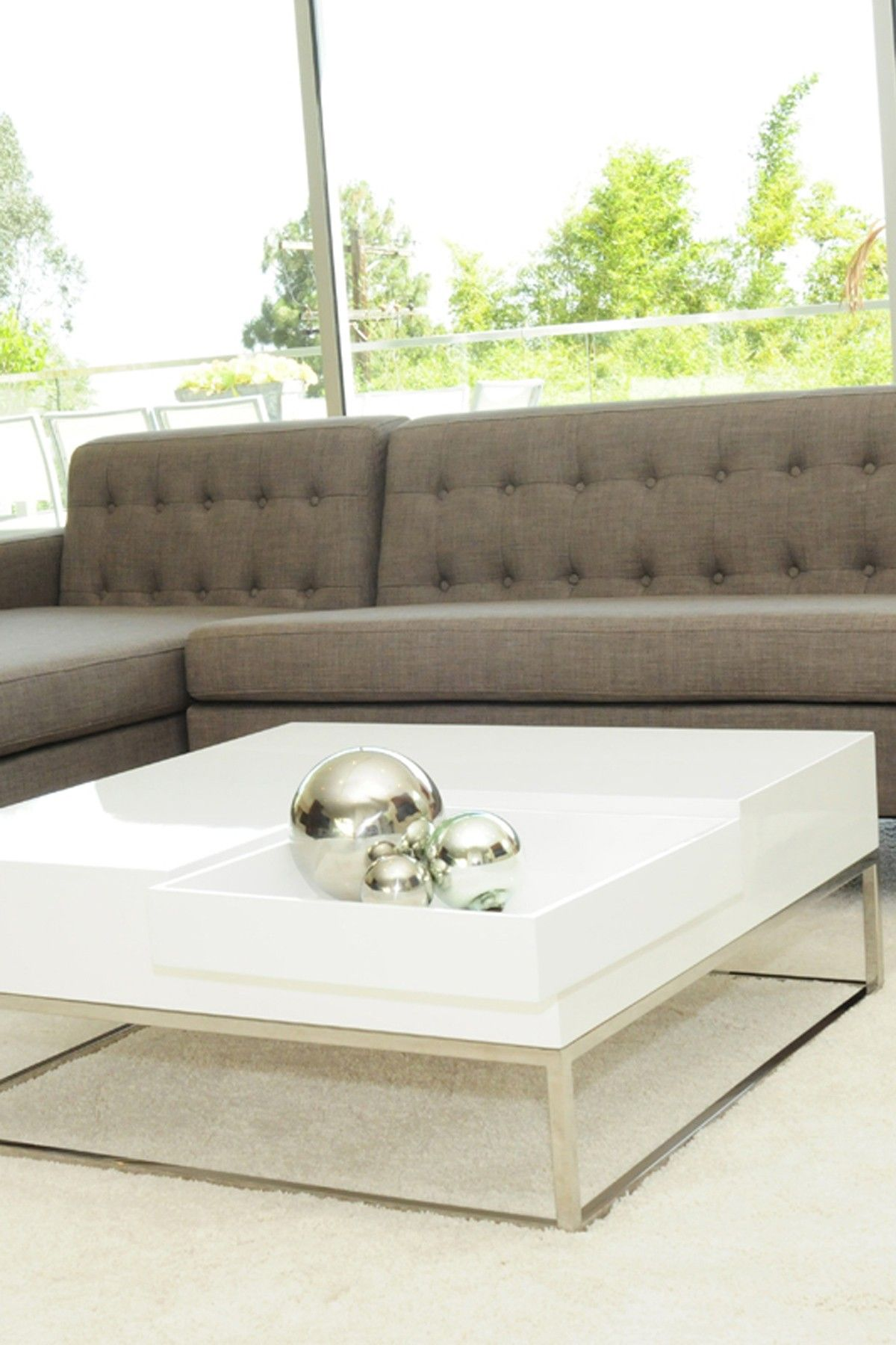 Love the sofa and the coffee table.  Audrina Coffee Table - White
