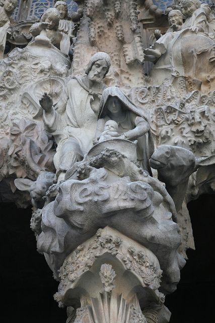 """España, Barcelona : templo expiatorio de la sagrada Familia, 1882 - 2010, arch. A.Gaudí : Fachada de la Natividad : """" puerta de la caridad """", via Flickr."""