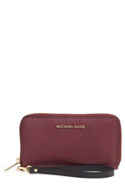 e74dcefcd366 Handbags Michael Kors · Details Easily stash your smartphone and other  essentials in a sleek zip-around wallet cast