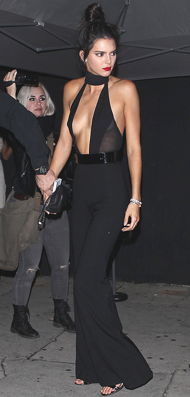 Kendall Jenner wears a plunging black Sergio Hudson jumpsuit at her 20th birthday party