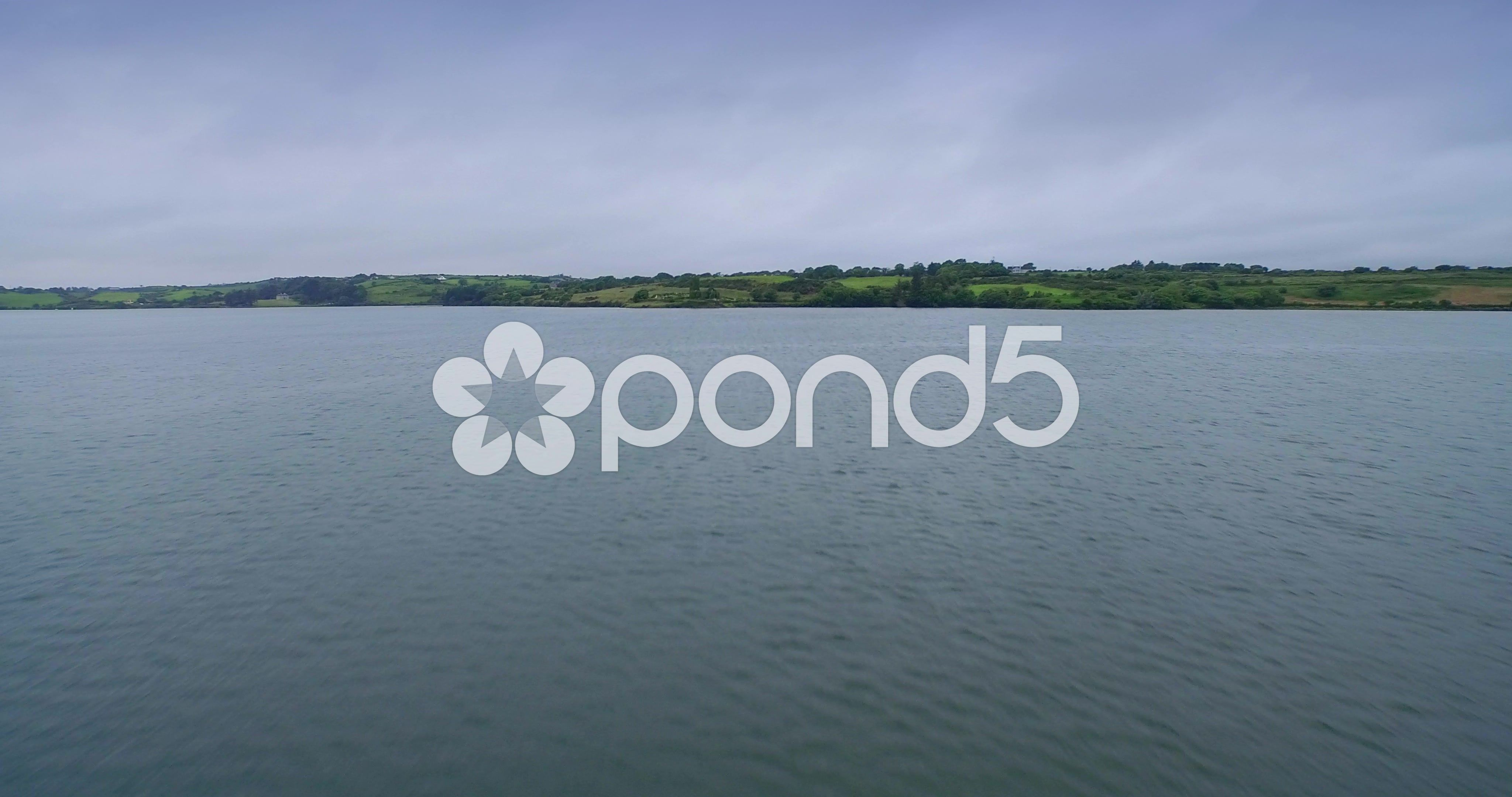 Aerial drone view of flying over irish estuary to an