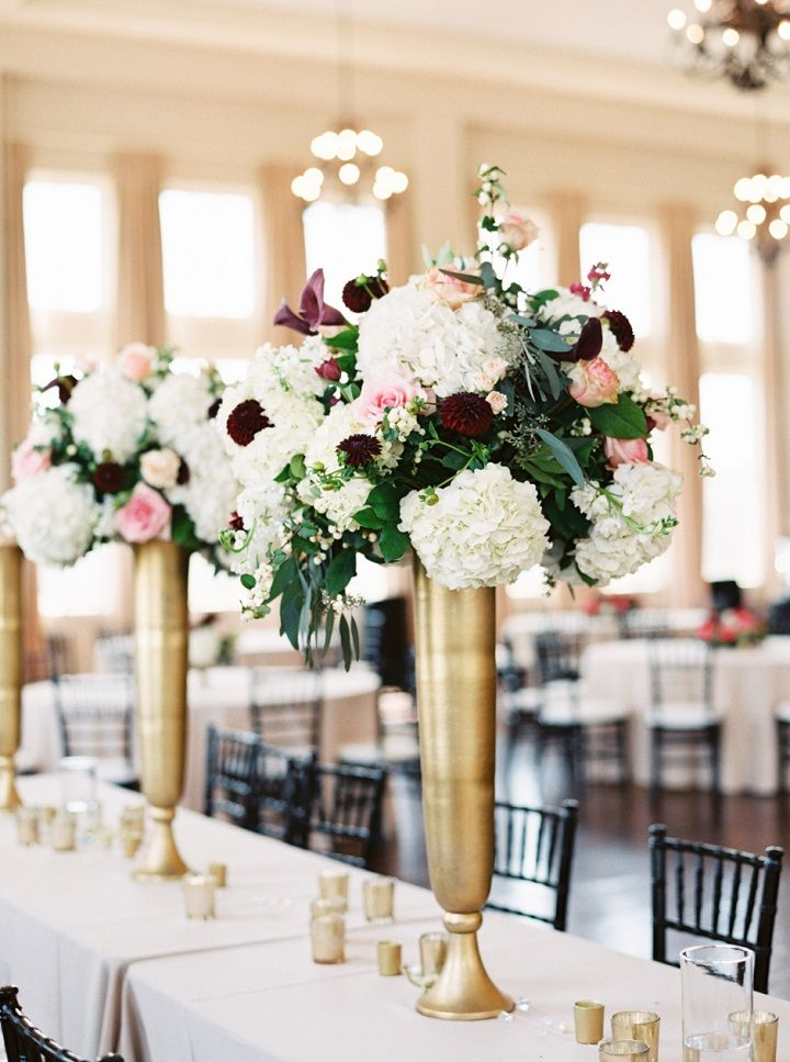 Tall wedding flower arrangements in Tall gold vases | itakeyou.co.uk #tallcenterpieces