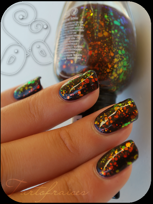 Kleancolor - Chunky Holo Black 236. Love this color.  I wore it over black.  One direction it looks green and the other orange.  Very striking.