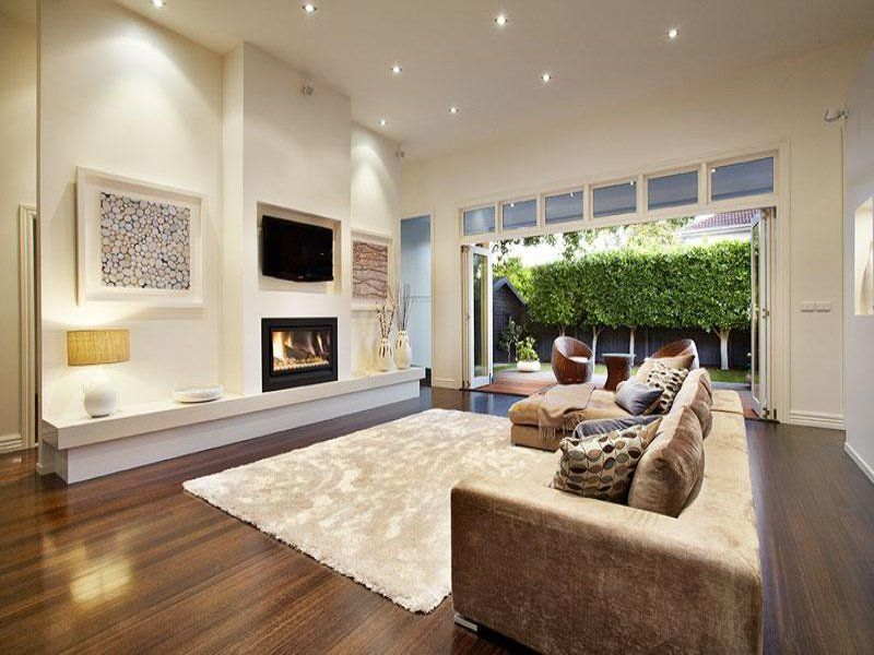 comfortable family room renovation design with light brown sofa feat cushion and rug on dark laminated - Home Renovation Design