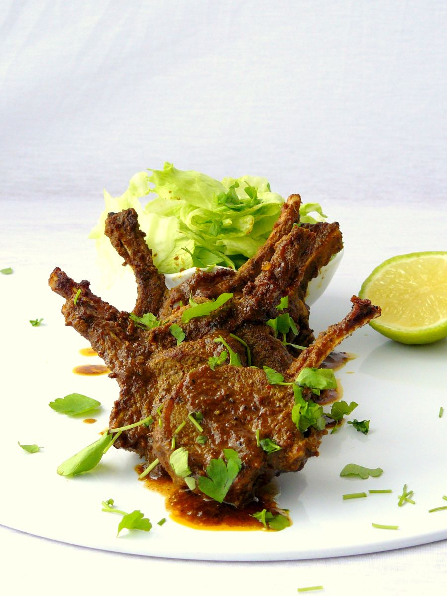 Succulent, Delicately Frenched Lamb Chops Smothered With The Lipsmacking  Vindaloo Marinade, Pan Fried And Finished Off With A Dash Of Tomato Sauce.