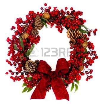 christmas wreath: A brown twig wreath is decorated with red berries, pine cones and a red damask bow. Stock Photo