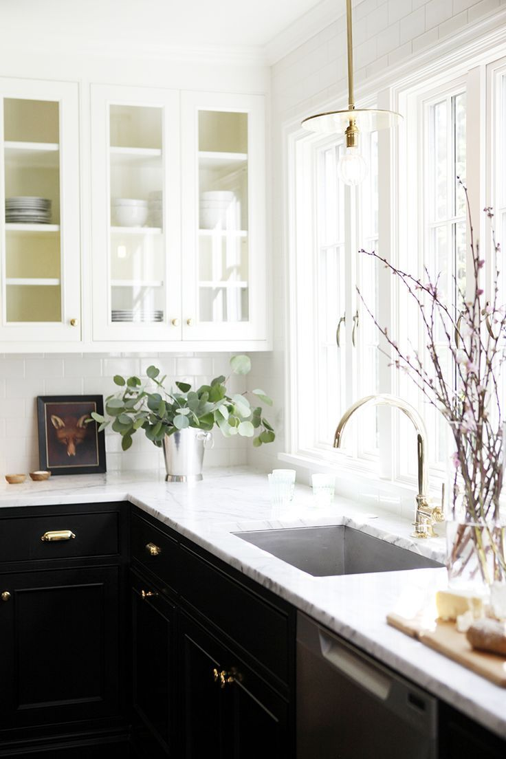Black and white kitchen. H2 Design + Build restored a tired cottage ...