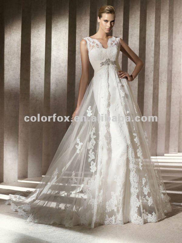 Seductive Lace Shoulder Empire Waist With A Sheer Lace Overlay Wedding Dress Pronovias Wedding Dress Tulle Wedding Dress Ivory Wedding Dress
