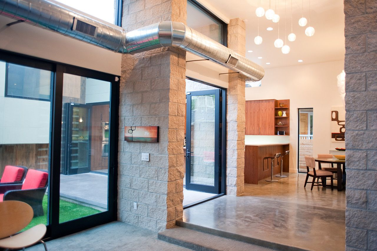 Denver Custom Home Showing Exposed Duct Work Interior Masonry And Exposed Concrete Floors