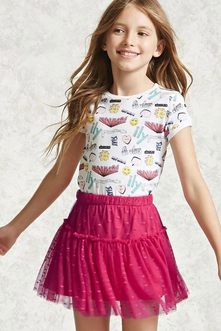 a7e567e368 Forever 21 Girls - A knit skirt featuring a heart-shaped swiss-dot fabric,  a shirred hem, and an elasticized waist.