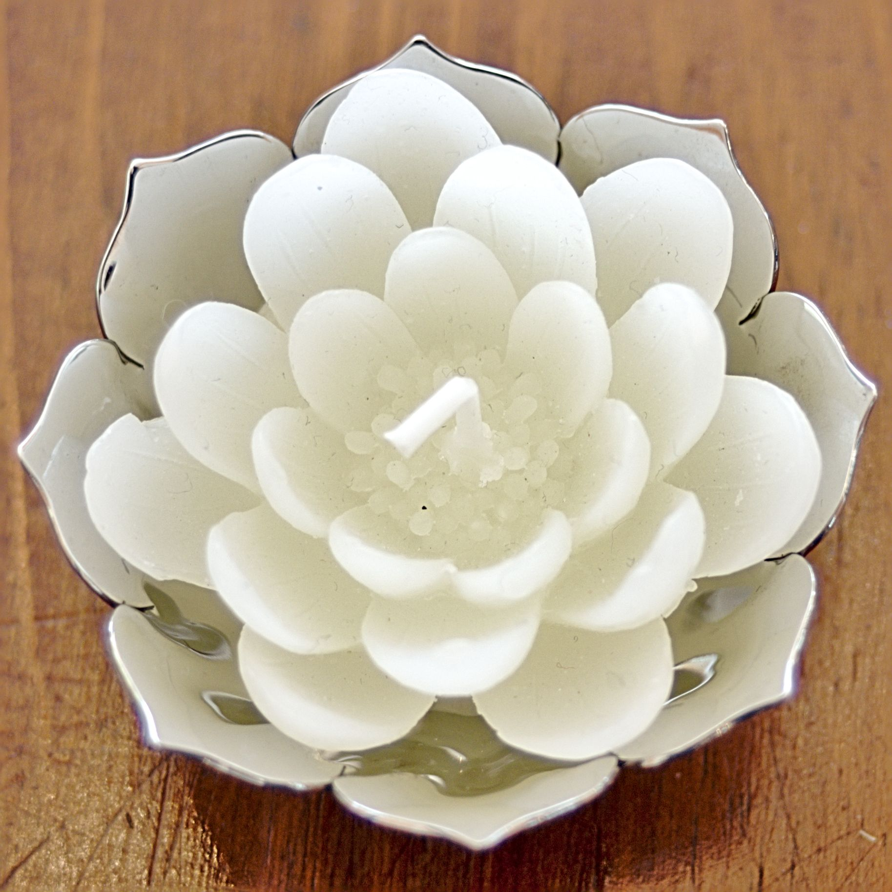 White lotus candles in lotus offering bowl lovely buddhist delicate white lotus flower candles are unscented and made paraffin wax with cotton wick burn time is 2 hours set of 4 candles dhlflorist Image collections