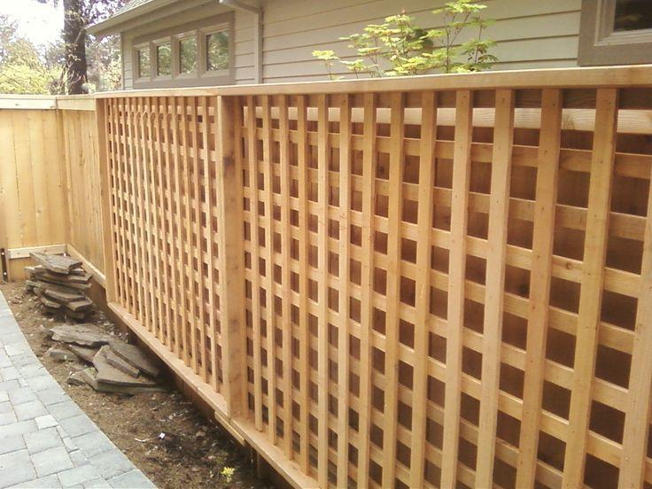 Square lattice panels attached to fence for trumpet vine for Wood lattice trellis