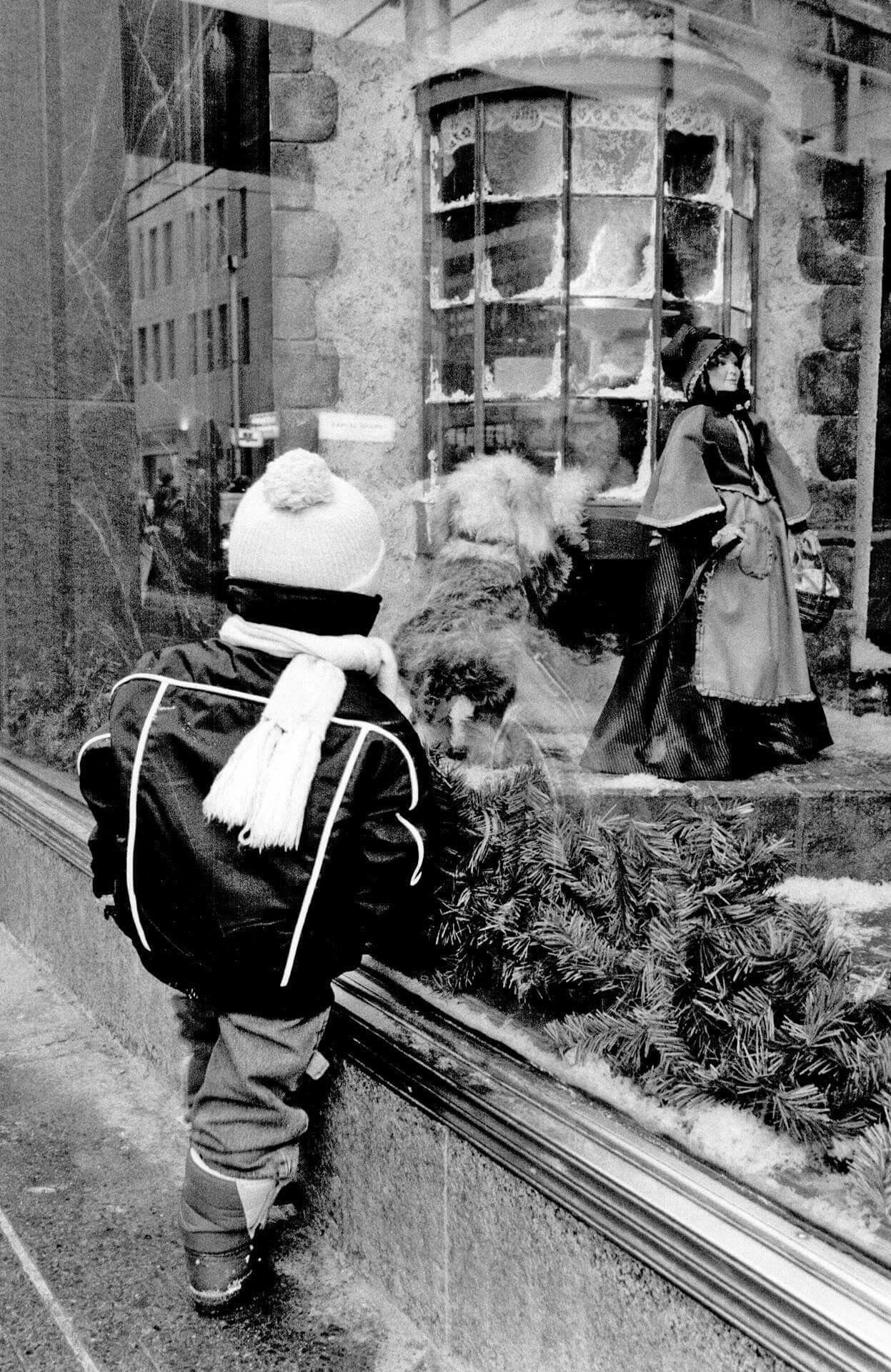 """""""Lost in thought: Shawn Hall, 3, is absorbed by a window display at Simpson's."""" Photo by Dick Loek, Dec. 19, 1988. - Courtesy of Toronto Public Library & the Toronto Star Archives."""