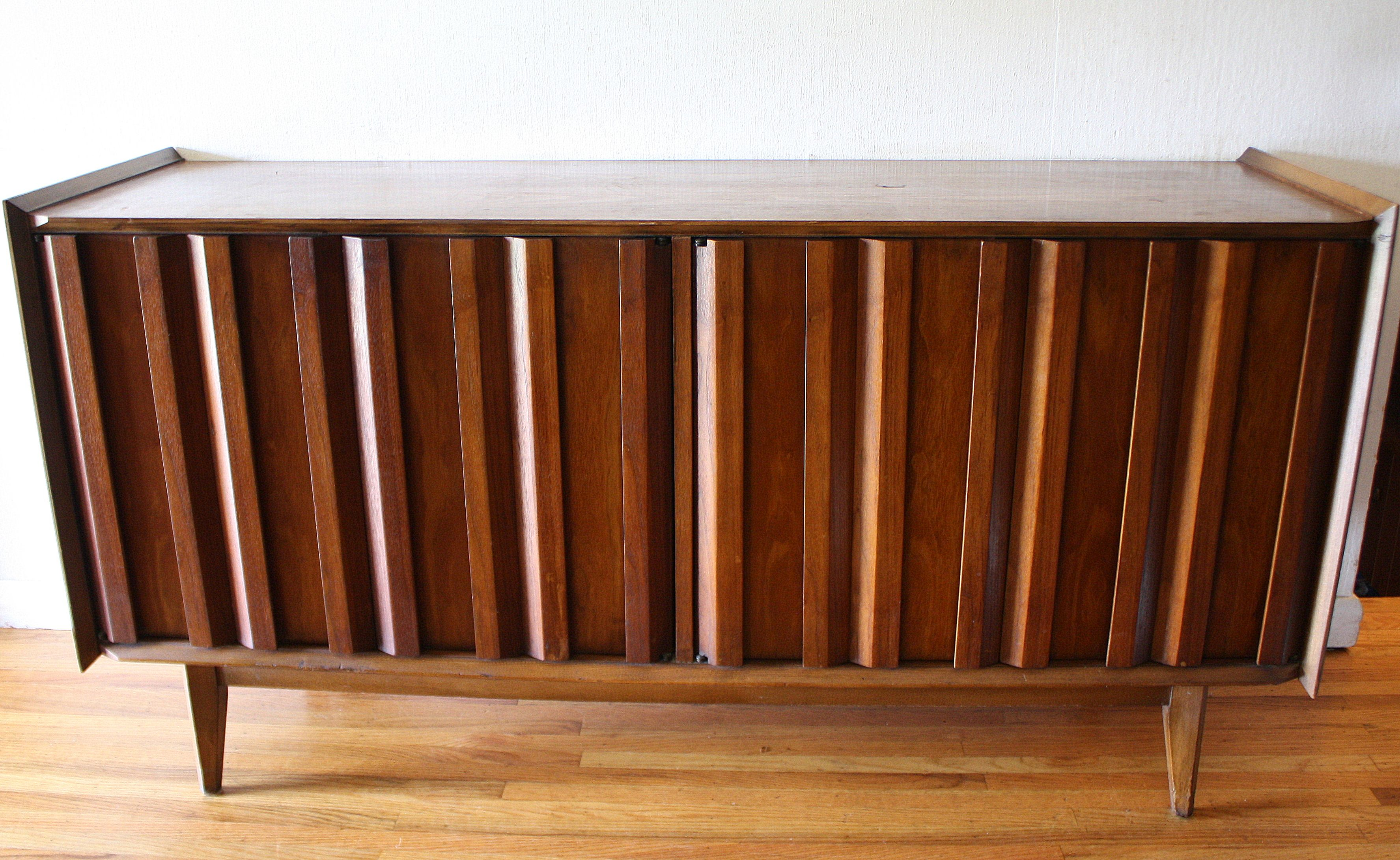 Mid Century Modern Credenza With A Vertical Slatted Design Incorporated Into The Cabinet Doors