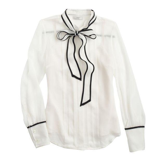 witte blouse met zwarte bies