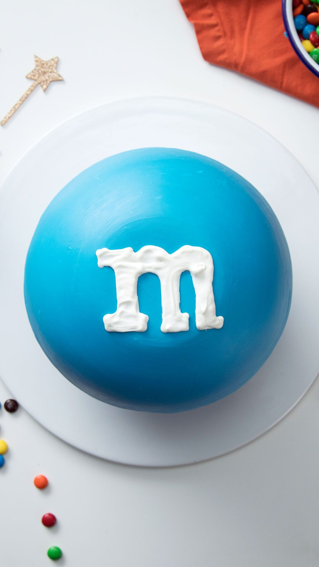 True M&M aficionados will love this embiggened M&M cake wrapped in a candy shell and stuffed with even more M&Ms.