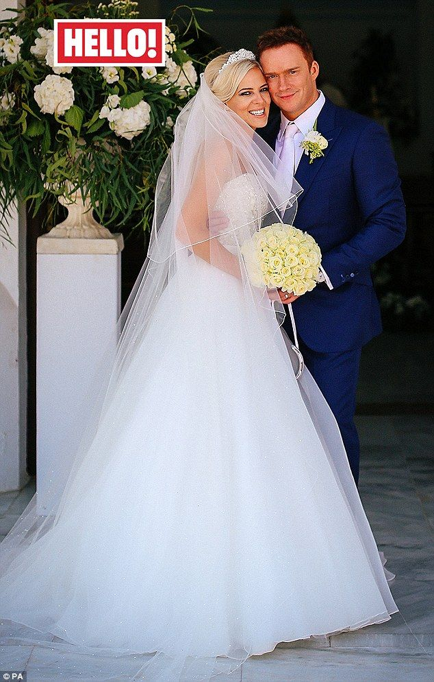 'Fairytale ending!' English tenor Russell Watson and his new wife Louise Harris said 'I do' during intimate nuptials held at mountain village Benahavis in southern Spain