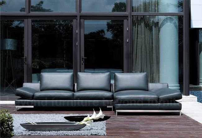 This modern chic grey fabric chaise lounge is giant in proportion ...