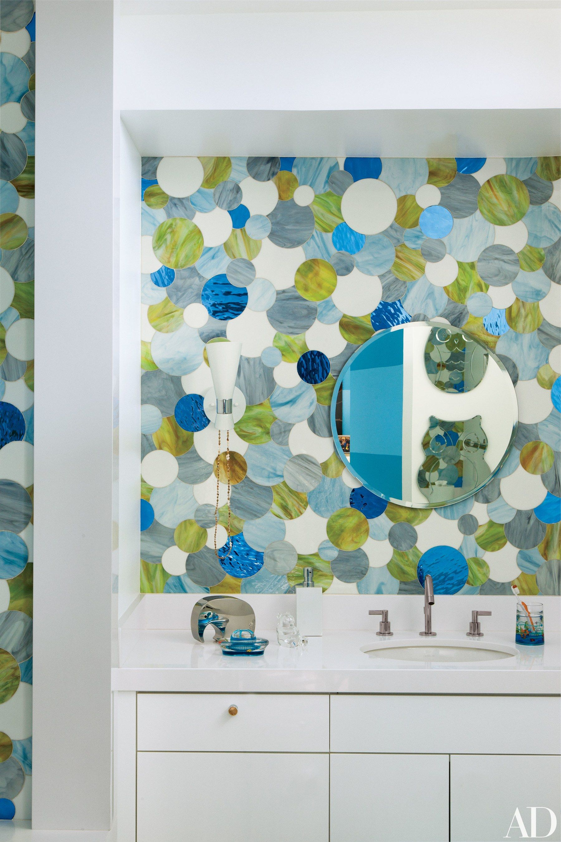 The children\'s bath features a vintage sconce from JF Chen, an IKEA ...