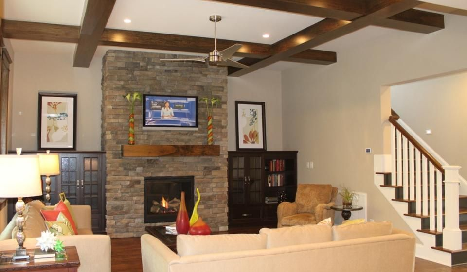 dark wood ceiling beams stacked stone fireplace and rustic wood