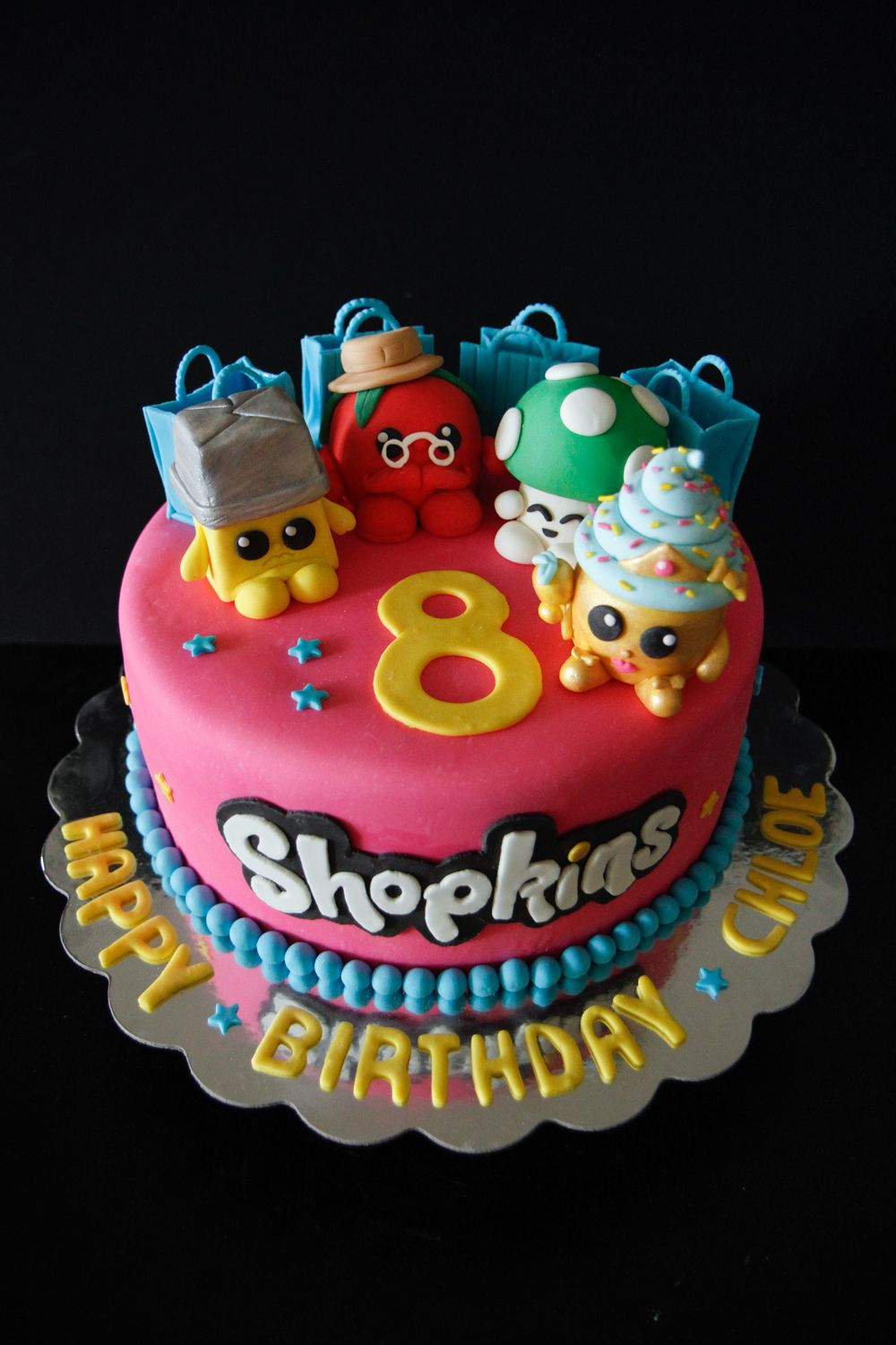 Its a Shopkins cake Buttercup Papa Tomato Miss Mushymoo and
