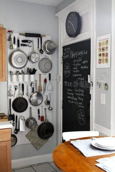 The simple DIY pegboard wall in this tiny kitchen is a great space-saving idea to get more storage space in a small kitchen. More tiny kitchen ideas here: http://outintherealworld.com/diy-home-kitchens-tiny-kitchen-decor-remodeling-ideas-love/