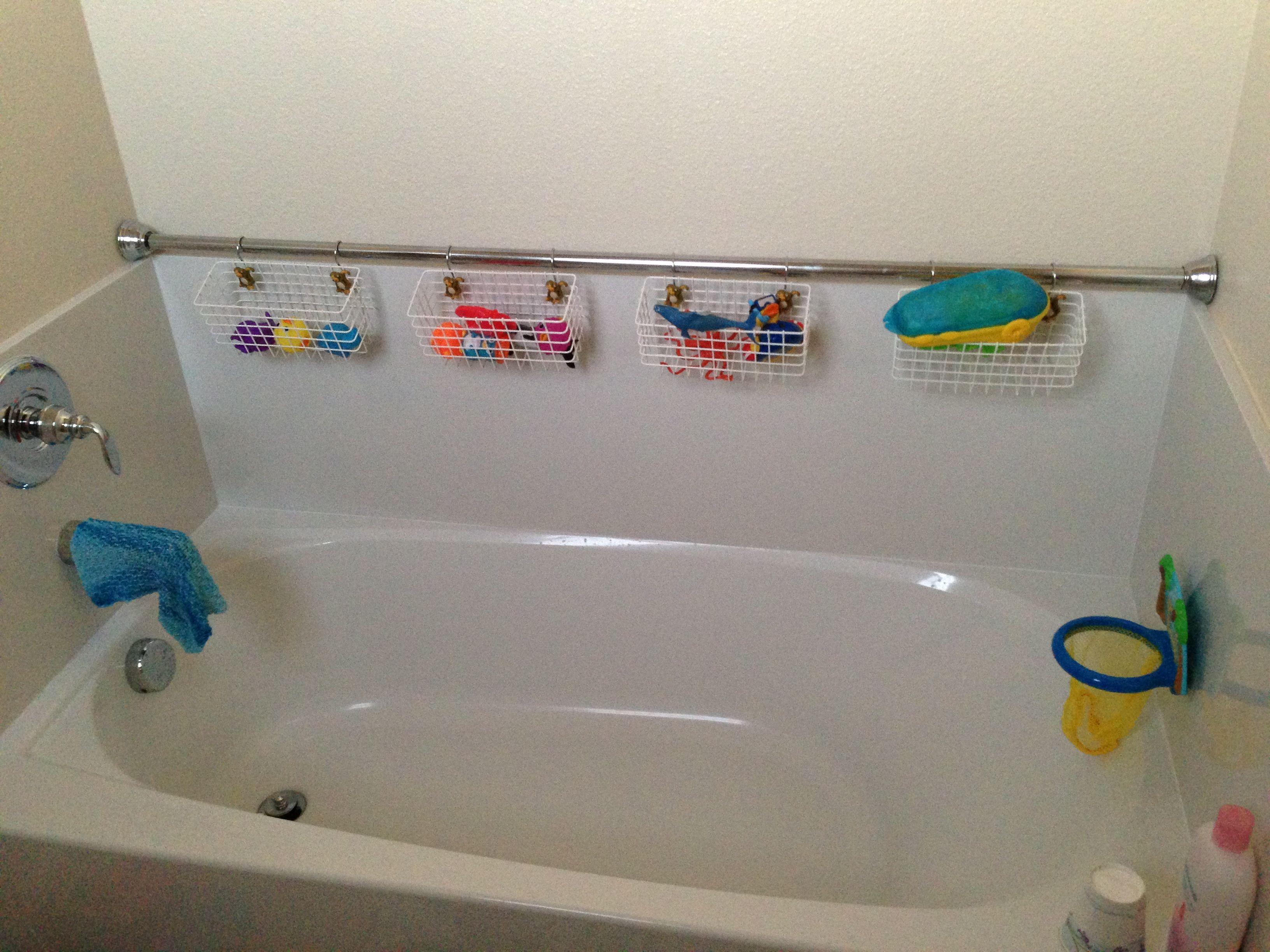 Using ikea baskets and shower curtain hooks for tub toy Kids storage ideas
