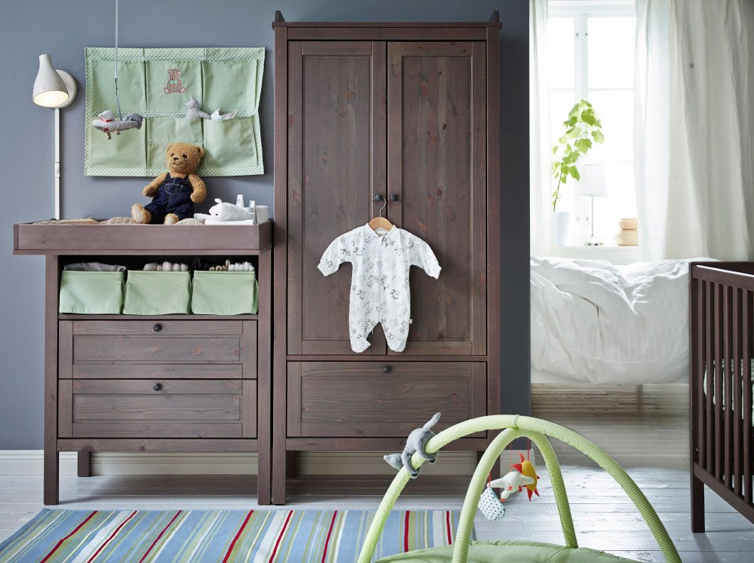A Baby Room With Grey Brown SUNDVIK Changing Table, Wardrobe And Crib