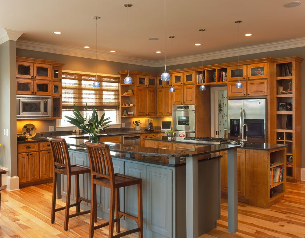 Maple cabinetry accentuated the hickory flooring in this ...