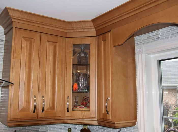 Diagonal Upper Cabinets With Clear Glass Door And Glass Shelves