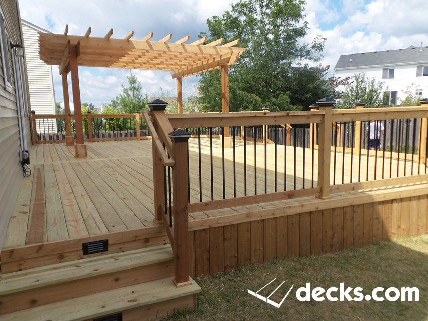 This Is A Deck With Pressure Treated Decking With Cedar Rails Trim And Skirting One Side Of The Deck Contains A P Pergola Pictures Deck With Pergola Pergola