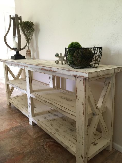 This rustic farmhouse style console/entryway table is a solid pine construction and is available in any stain preference. Table can be used as an entertainment console table, foyer table or sofa table. All pieces are custom and may differ slightly from sample image. Sample image is in a weathered grey beach stain bringing out the natural beauty of the wood. Each piece is triple coated in a natural wax that provides both protection and a beautiful smooth finish. Rustic metal hardware adds the ...