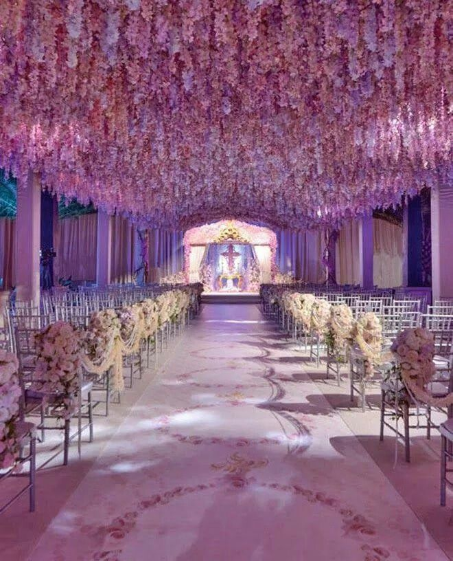 The Wisteria Is So Beautiful Wedding Reception Flower Arrangements Wedding Flower Arrangements Wedding Reception Flowers
