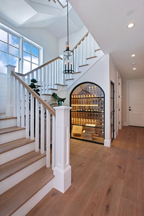 Showcase stairway love the wine cooler built under the for Tv showcase designs under staircase