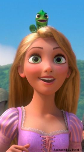 i love how pascal always sits on top of rapunzel s head disney
