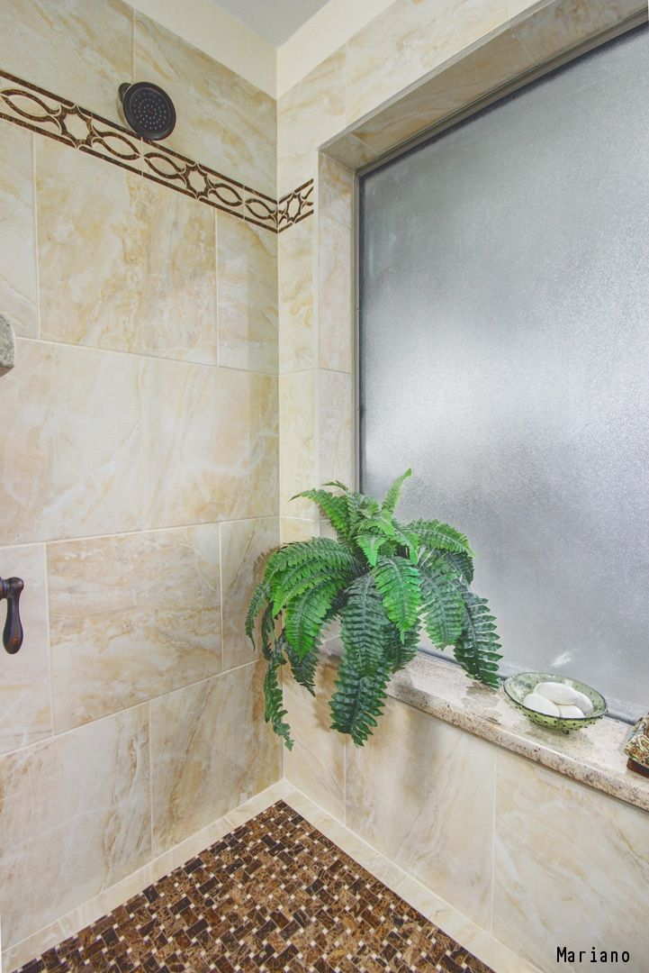 A Stunning Shower With Tile Walls And A Large Window The Average