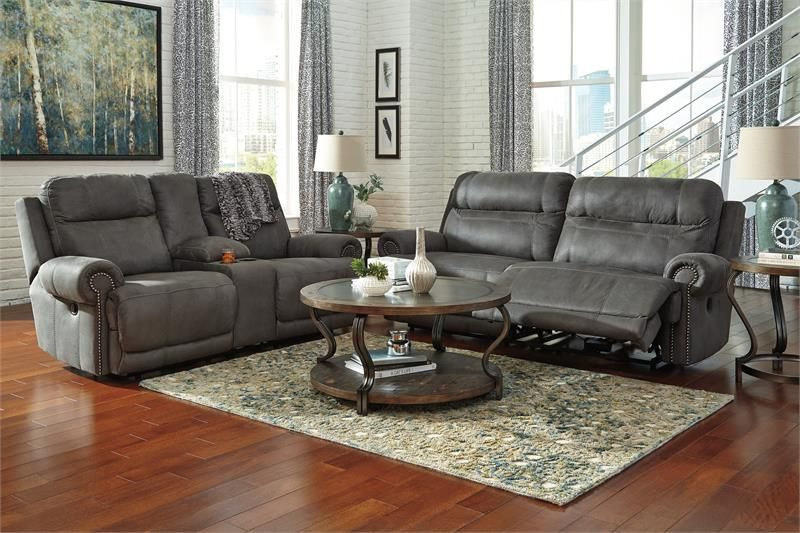This Double Reclining Sofa and Loveseat with console storage and cup