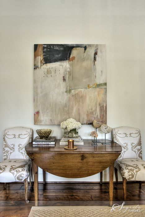 large-scale art, drop-leaf table, interesting print on those chairs, well balanced display of objects