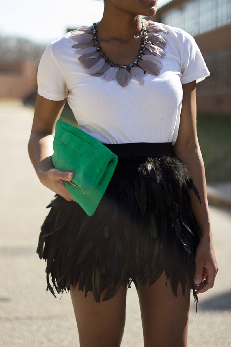 Add a pop of the #ColoroftheYear to your Black & White Outfit.  We love this #Emerald clutch paired with this fab feathery look from @Ashleigh (The Daileigh)!