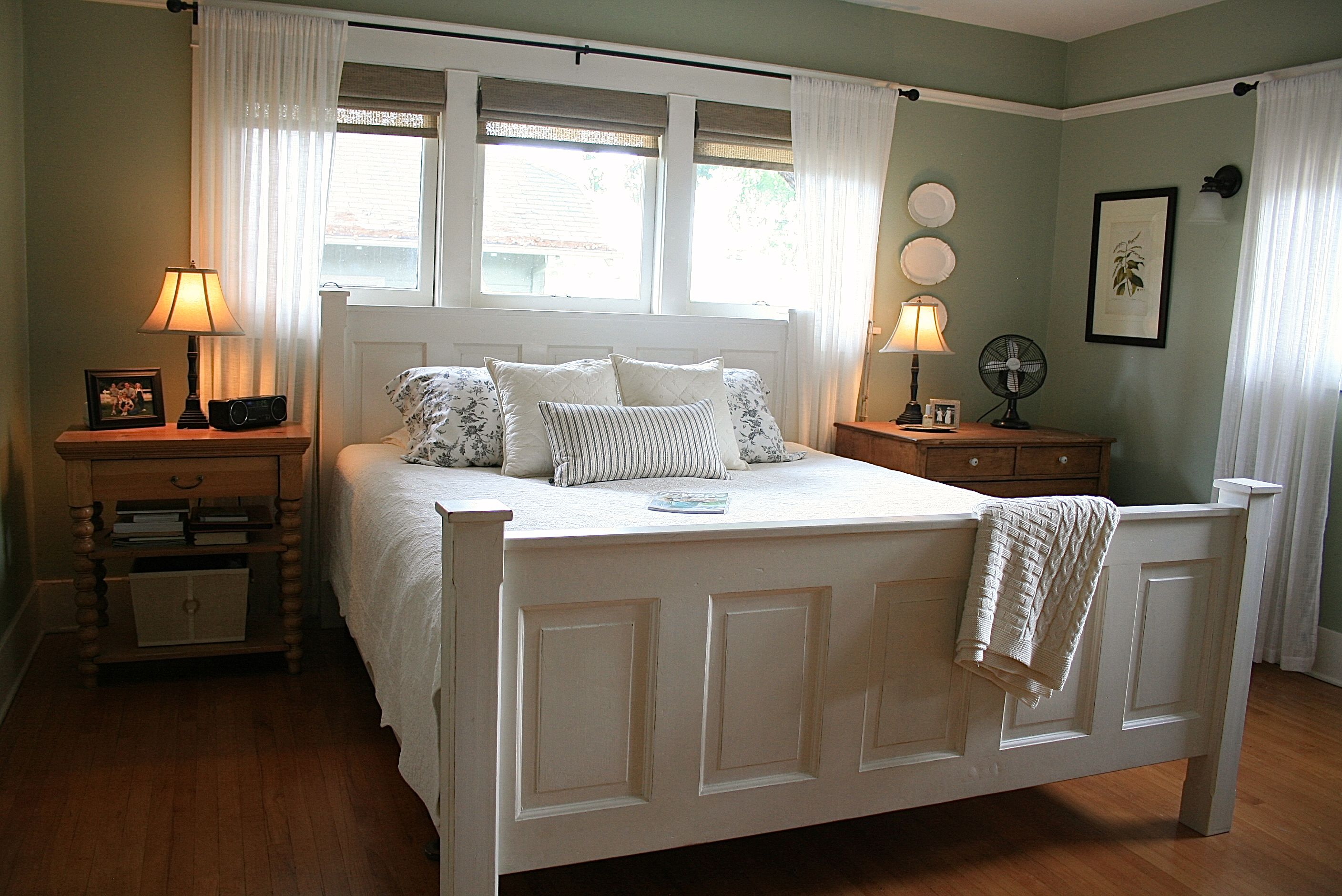 old doors used as a headboard footboard add character to this