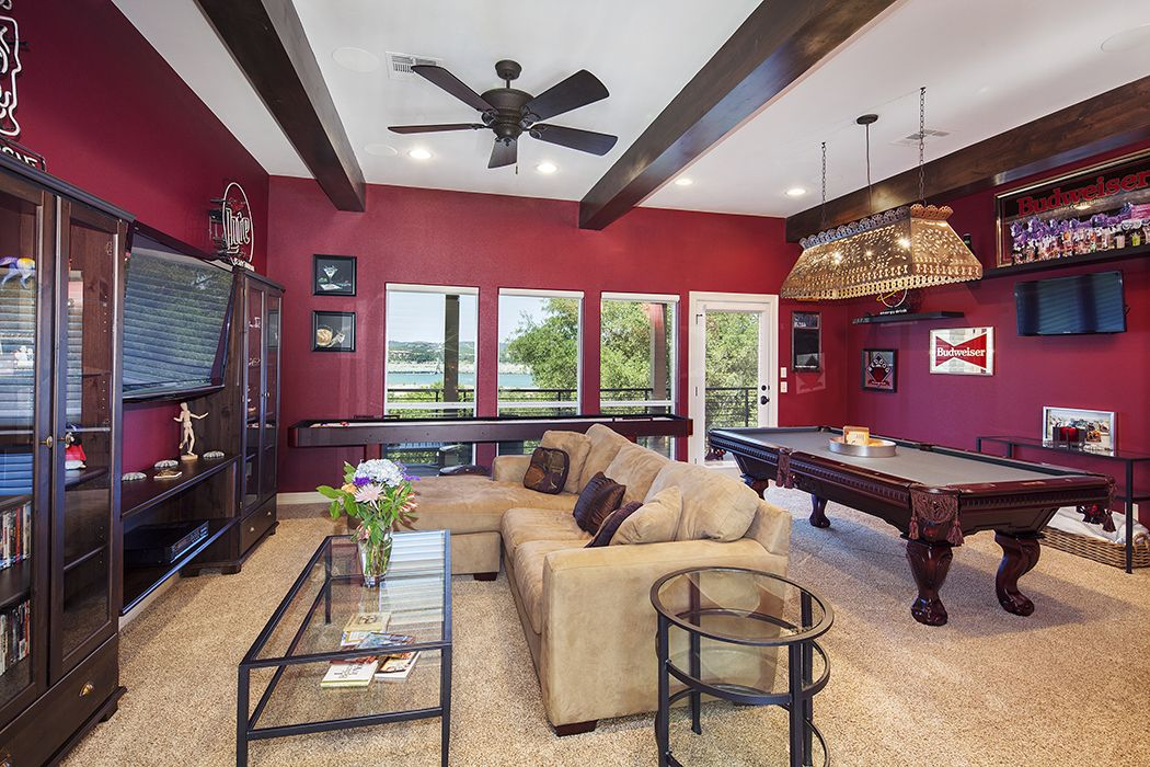 Www Newhousebuilder Com Shuffleboard And Pool Tables Provide Plenty Of Entertainment In This Gameroom Wit Family Room Decorating Family Room Family Room Design