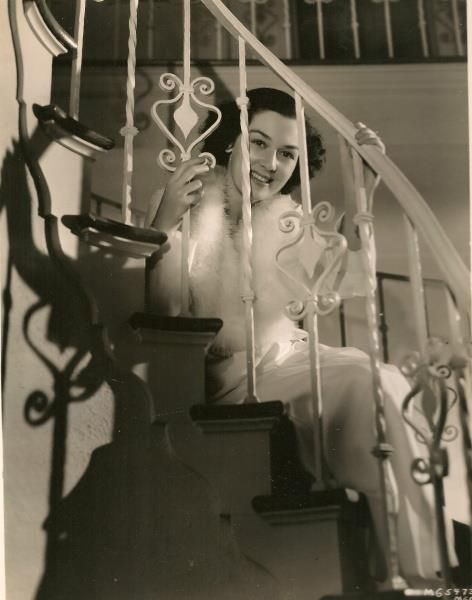 Rosalind Russell sitting on a staircase, circa 1930s